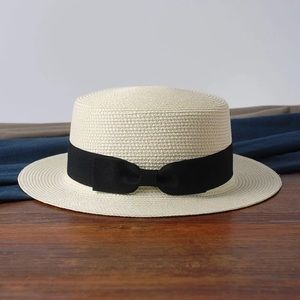 Straw hat with black bow